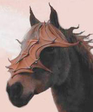 Leather mask on fantasy horse with flowing mane.