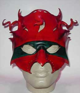 Mask/headress, in shades of orange, red and green.