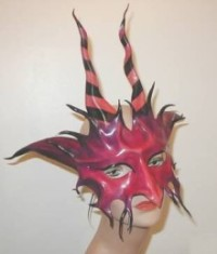 Red leather mask with shading, striped horns & fangs.